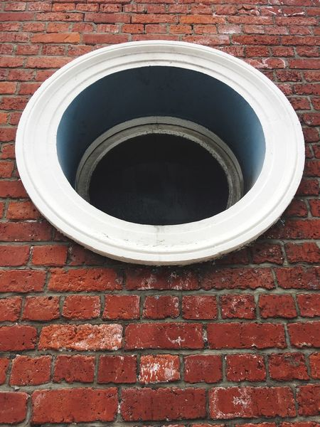 The circular window in the brick wall Circular Circular Window Window Brick Wall Red Circle Architecture Built Structure