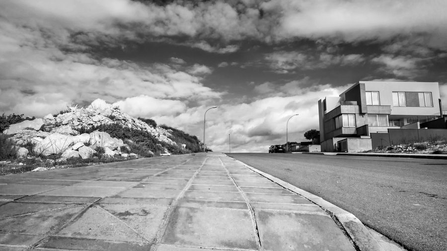 Cloud - Sky Sky Building Exterior Transportation Built Structure Road Architecture Nature No People The Way Forward Day Direction Outdoors City Beauty In Nature Diminishing Perspective Mode Of Transportation vanishing point Land Vehicle Black And White Blackandwhite EyeEm EyeEm Best Shots EyeEm Selects