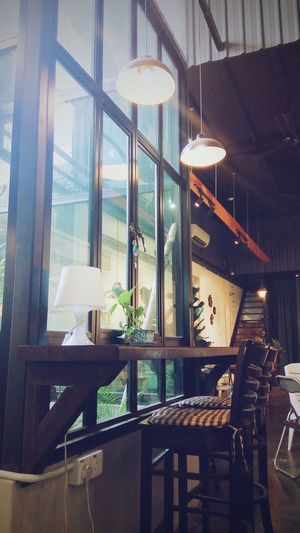 Window Indoors  Old-fashioned No People Architecture Day Wooden Chair Down Light Incandescent Modern Tree Bulb Window Light Long Table Cafe Desk Lamp