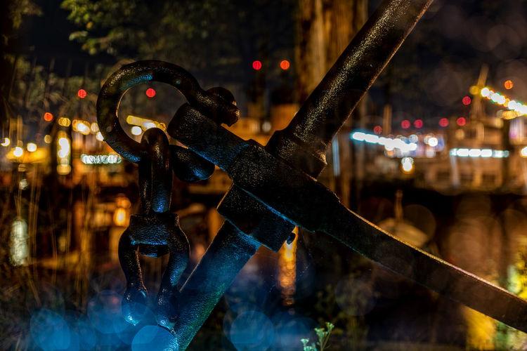 Close-up of metallic equipment outdoors at night
