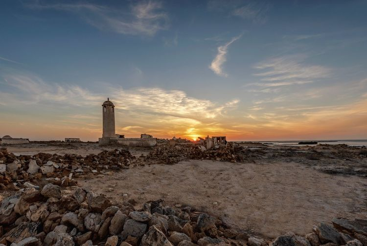 Historical ruins sunset Sky Lighthouse Sea Tower Beach Architecture Built Structure Guidance Water Building Exterior Sunset Cloud - Sky Land Building Scenics - Nature Nature Beauty In Nature Tranquility Tranquil Scene Horizon Over Water