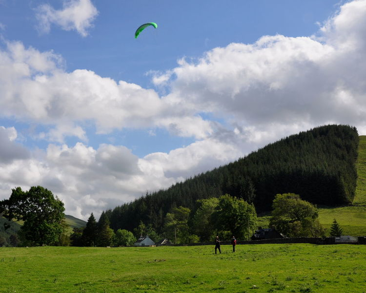 Grass Power Kiting  Scotland St. Mary's Loch Beauty In Nature Cloud - Sky Day Forest Grass Green Color Landscape Leisure Activity Lifestyles Men Nature One Person Outdoors Paragliding People Real People Scenics Sky Sport Tree Vacations