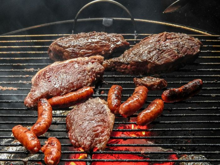 Sausages and meat on barbecue grill