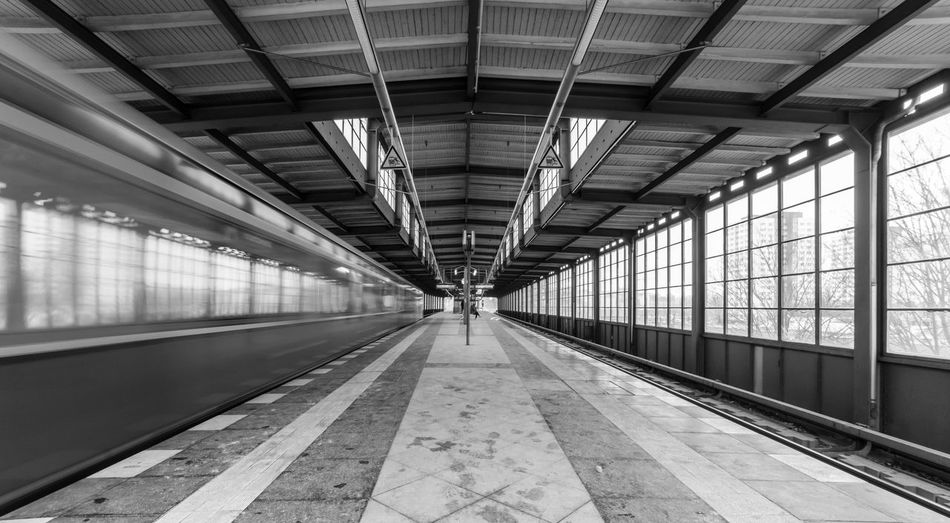 Speeding train at railroad station