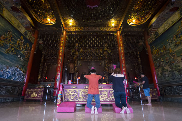 Benoa, Bali, Indonesia - January 28, 2017 : People praying and wishing a happy chinese new year on vihara satya dharma. Adult Altar Architecture Belief Building Built Structure Full Length Group Of People Indoors  Luxury People Place Of Worship Praying Real People Rear View Religion Spirituality Standing Togetherness Women