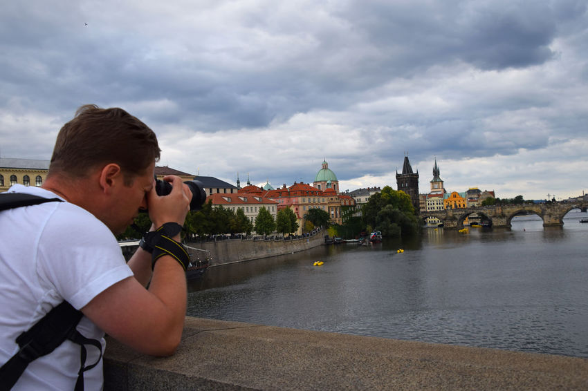 Prague old city view and photografer Europe Trip Historical Building Karlův Most Man Prague Prague Bridge Tourist Travel Trip Your Ticket To Europe Architecture Bridge Building Exterior Built Structure Cloud - Sky Been There. Europe One Person Outdoors Prague Old Town Real People Sky Tourism Tranquil Scene Travel Destinations An Eye For Travel Stories From The City