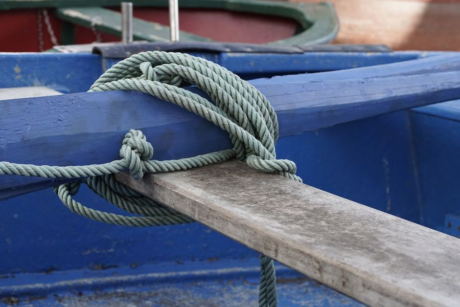 Ropes On A Boat Boat Selective Focus Focus On Foreground Bildfolge Photography Madeira Island Vacation Time Light And Shadow Rope Rope Strength Tied Knot Tied Up Harbor Nautical Vessel Rolled Up No People Day Connection Transportation Outdoors Fishing Net Moored Blue
