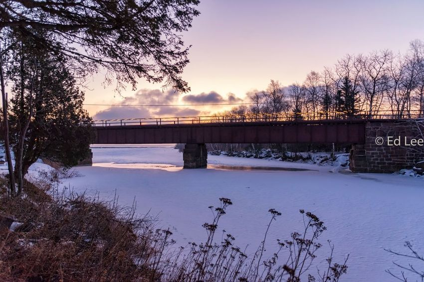 Good morning, Knife River Minnesota Sunrise Sunrise_sunsets_aroundworld Streamzoofamily Malephotographerofthemonth Bridge - Man Made Structure Connection Tree Winter Sky Cold Temperature Nature River Architecture Snow Built Structure Outdoors No People Beauty In Nature Scenics Day Water Bridge