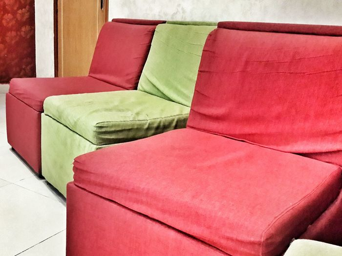 Red And Green Sofa In House