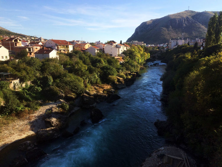 Autumn Colors Balkan Mostar Mostar Bosnia Mostar Bridge Mostar ♥ River View Riverside Architecture Balkans Beauty In Nature House IPhoneography Mobilephotography Mountain Nature Neretva Neretva River No People Outdoors River Sunny Day Town View From Above Water