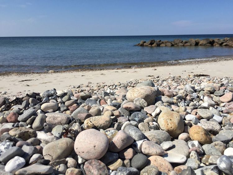 Sea Beach Water Shore Horizon Over Water Pebble Nature Tranquil Scene Tranquility Beauty In Nature Scenics Rock - Object Pebble Beach No People Outdoors Day Clear Sky Sky Sand