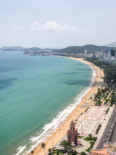Travel Destinations View From Above Vietnam Nha Trang Urban Skyline Skyscrapers Cityscape Bay Sea View Ocean Aerial Shot Aerial View Water Beach Sea Land Sky Incidental People Nature Beauty In Nature Sand High Angle View Architecture Scenics - Nature Cloud - Sky Coastline Holiday Built Structure Building Exterior Outdoors