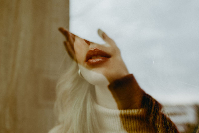 Close-up of woman face seen through glass