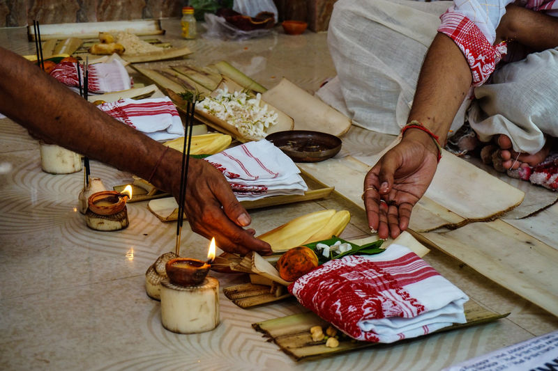 Cropped image of people during puja