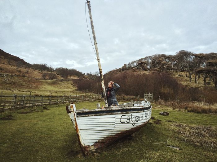 Man on boat against sky