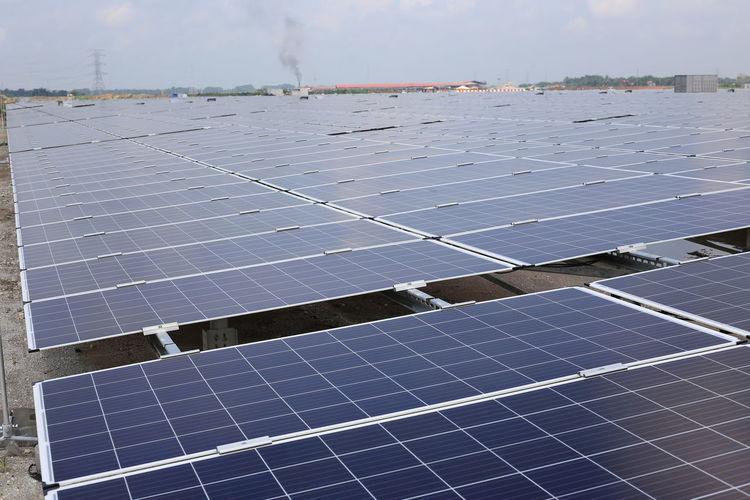 large scale solar farm Alternative Energy Architecture Built Structure Business Day Electricity  Environment Environmental Conservation Environmental Issues Fuel And Power Generation Nature Outdoors Pattern Power Supply Renewable Energy Roof Silver Colored Sky Solar Energy Solar Panel Sun Sustainable Resources Technology