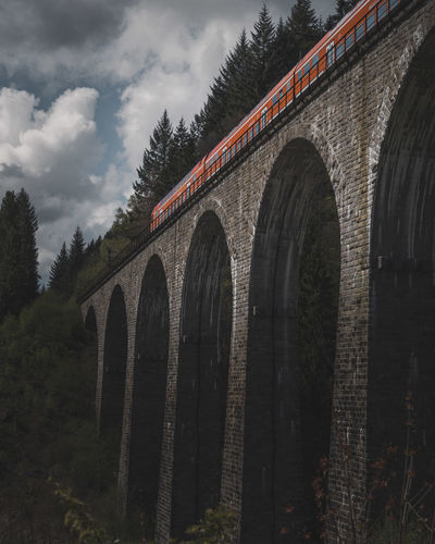 Arch Architecture Beauty In Nature Bridge - Man Made Structure Built Structure Connection Day Growth Low Angle View Mood Nature No People Outdoors Red Sky Train Transportation Tree Viaduct