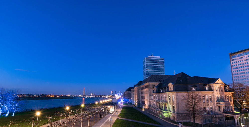 Blue hour at river Rhine in Duesseldorf Architecture Building Exterior Built Structure Sky Illuminated Blue City Copy Space Nature Building Dusk Clear Sky No People Night Travel Destinations Water Transportation Connection Bridge Modern Outdoors Office Building Exterior Cityscape