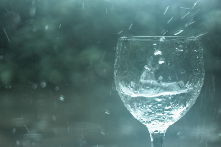 wine glass in the rain Abstract Alcohol Backgrounds Close-up Drink Drinking Glass Drop Drops Food And Drink Glass Glass - Material Green Imagination Moment Motion Purity Rain Reflection Refreshment Splash Still Life Transparent Water Wave Wineglass