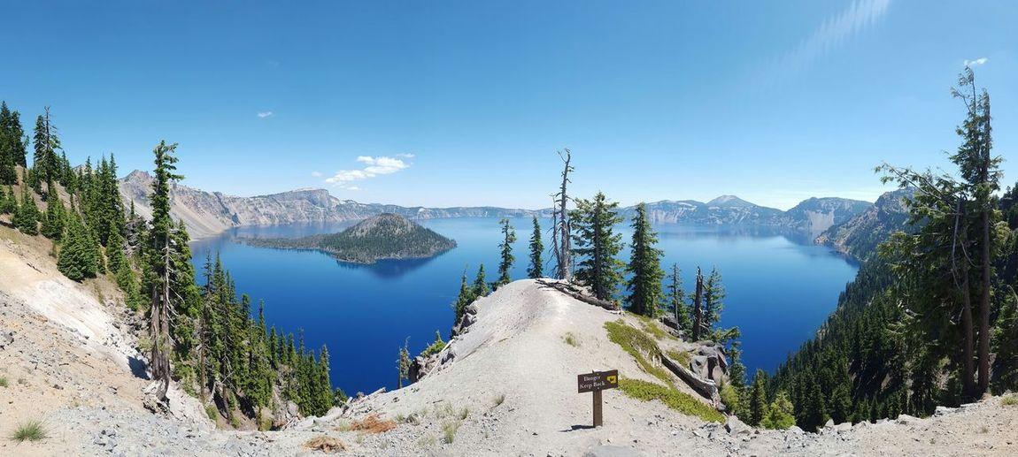 Calm Lake Against Mountain Range