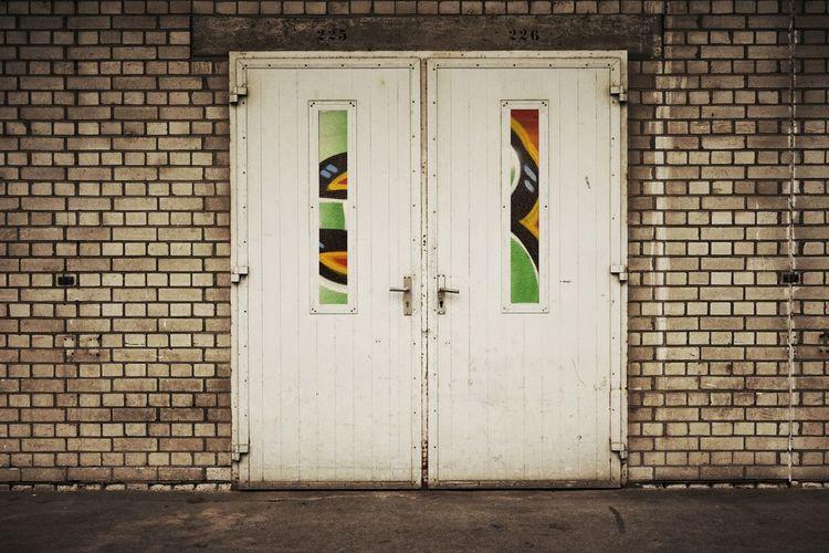 Closed door of brick house