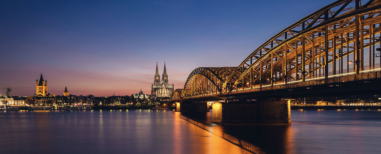 View of the Skyline of Cologne at sunset Cathedral Cityscape Cologne Old Town Rhine Skyline Architecture Bridge - Man Made Structure City Cityscape Cologne Cathedral Germany Hohenzollernbrücke Illuminated Night No People North Rhine Westfalia Outdoors River Sky Sunrise Sunset Travel Destinations Water Waterfront