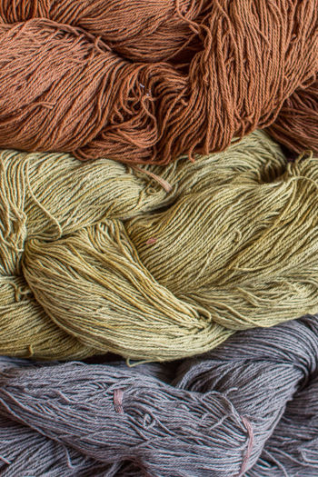 Art And Craft Backgrounds Ball Of Wool Brown Close-up Craft Creativity Day Full Frame High Angle View Indoors  Large Group Of Objects Material Multi Colored No People Softness Still Life Textile Thread Variation Wool