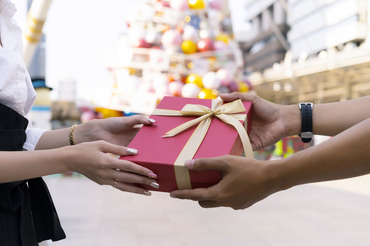 Give up hand Couple love giving a gift box . Happy relationship in outdoor scene. Love and relationship concept on special occasion with christmas background.. Give Gifts With Love Give Gift Present Valentine Give Gift Couple Couple Lovers Gift Boxes Gift Box In Hands Happy Time People Close-up Celebration Gift Box Hand Special Day Occasion Christmas Decoration Backgrounds Festive Season Festive Specials Romantic Lovers Celebration Tradition Traditional Festival