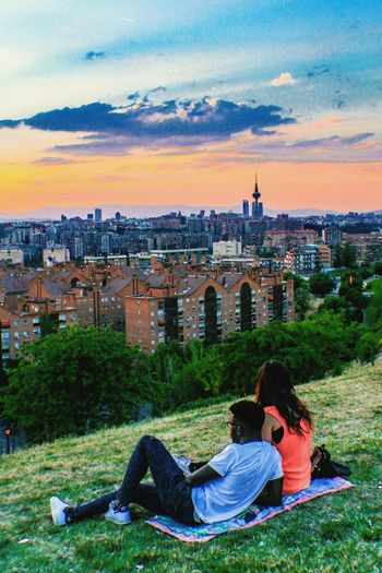 City Sitting Sunset Togetherness Lifestyles Cityscape Rear View Looking At View Casual Clothing In Front Of Relaxation Person Leisure Activity City Life Couple Check This Out Parque De Las Siete Tetas Cityscapes Mirador De Vallecas SieteTetas Madrid Spain Madrid EyeEm Gallery Cloud - Sky People And Places Adapted To The City The City Light