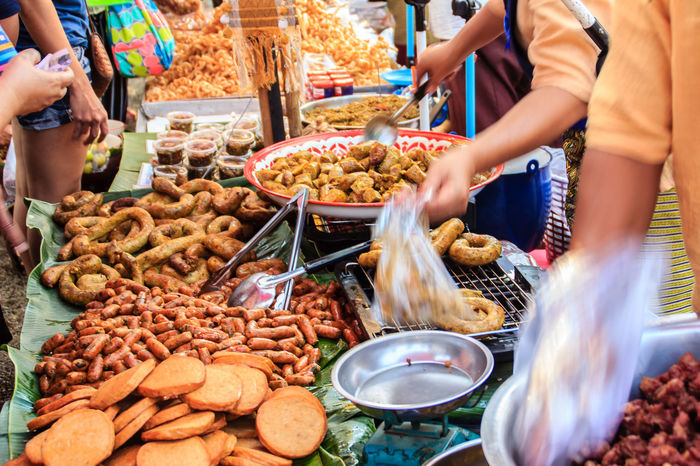 Bangkok, Thailand - January 17, 2015: Unidentified Thai venders selling variety of foods in local fresh market at Bangkok , Thailand. Seller And Customer Street Food Vendors Vendor Supplying Food Choice Day Fast Food Food Food And Drink Fresh Market Fresh Marketplace Freshness Large Group Of Objects Market Market Stall Marketplace One Person Outdoors People Ready-to-eat Real People Retail  Seller Seller And The Buyer Street Food Street Food Market Street Foods Variation Variety Of Food Vender