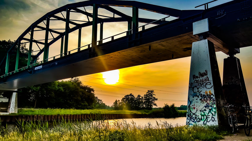 Sunsets Bridge - Man Made Structure Sunlight Water Sky Sunset Built Structure Cloud - Sky Sun Architecture No People Outdoors Nature Sunset_collection Holland 💕 Scenics Sunsets Of Eyeem Sunset And Clouds  Bridge View Bridges Graffiti Art Graffiti & Streetart Grafitti Sunset And Clouds  Sunsetsky Water Reflection