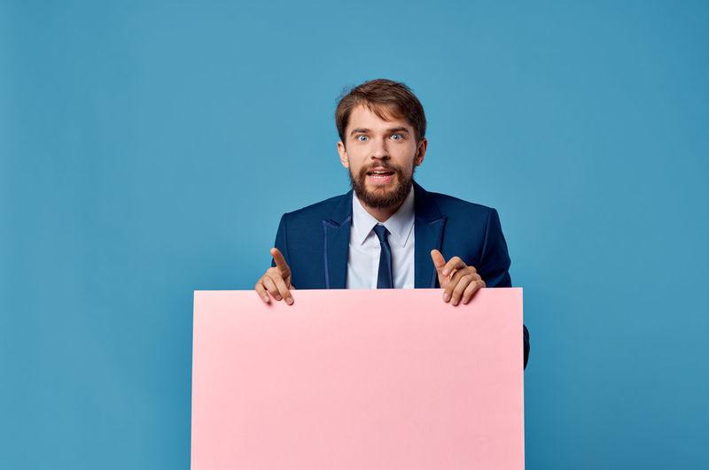 Portrait of man against blue background