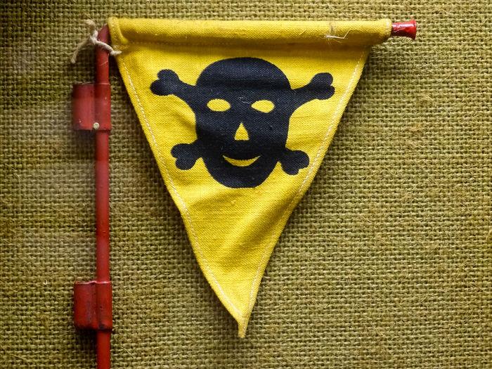 Close-up Danger Dangerous Day German Landmine Indoors  Landmine Landmines No People Red Skull And Crossbones Warning Flag Word War II Yellow