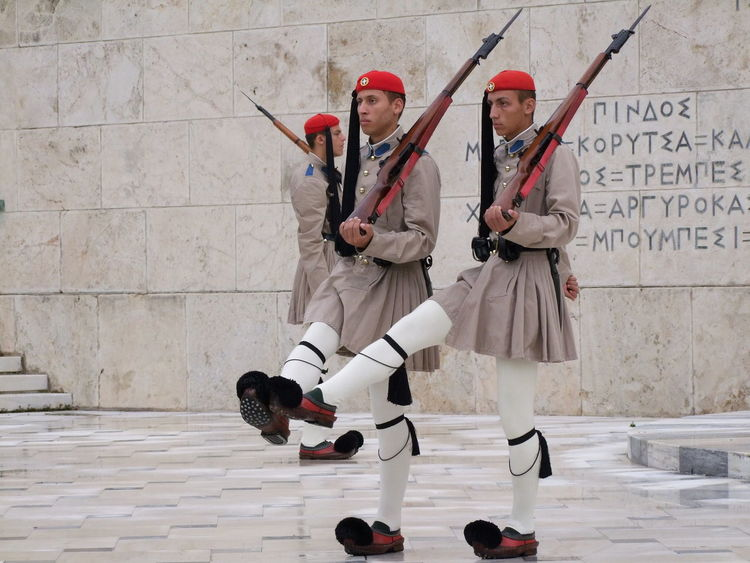 Changing of the Guard at Tomb of the Unknown Soldier Athens Balance Composition Friendship Front View Full Length Fun Greece Gun Hat Lifestyles Occupation Real People Red Red Hat Red Lips Riflessi Soldier Standing Young Adult