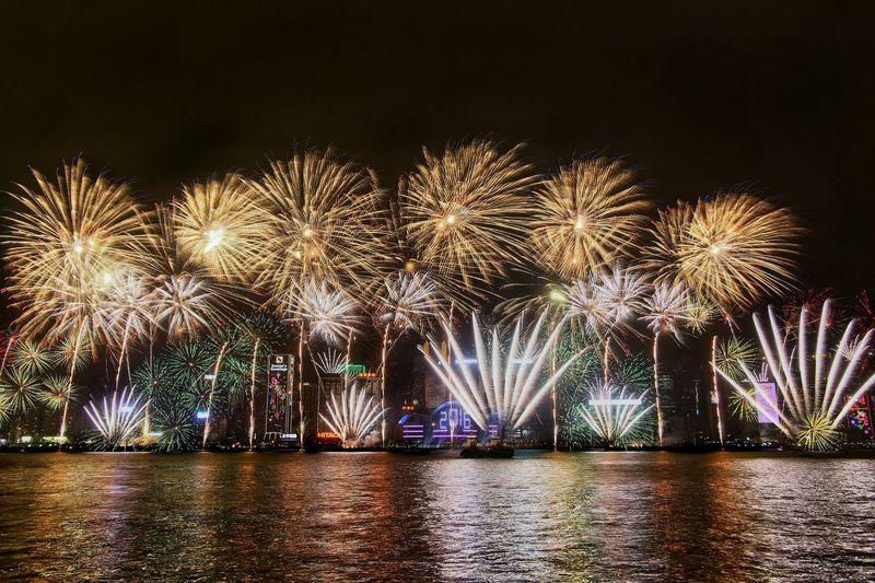 Illuminated firework display at victoria harbor