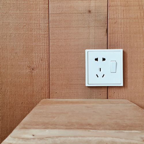 Close-Up Of Switch On Wooden Wall