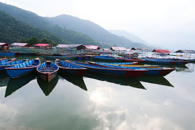 Phewa lake, pokhara Nepal Nautical Vessel Mountain Tradition Moored Wood - Material Outdoors Travel Transportation Tranquility Landscape Scenics No People Day Travel Destinations Mountain Range Nature Sky Multi Colored Sea Water Italian Food Mountains Sherpa Nepali  Trekking In Nepal pokhara