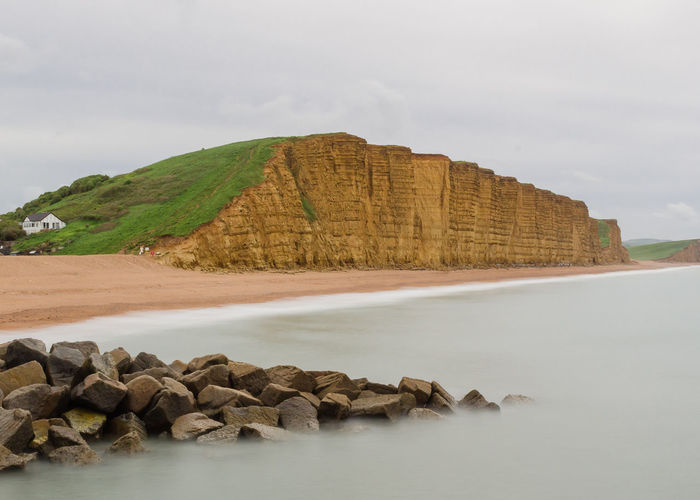 Dorset Beach Beauty In Nature Cloud - Sky Day Formation Idyllic Land Long Exposure Mountain Nature No People Non-urban Scene Outdoors Rock Rock - Object Scenics - Nature Sea Sky Solid Tranquil Scene Tranquility Water