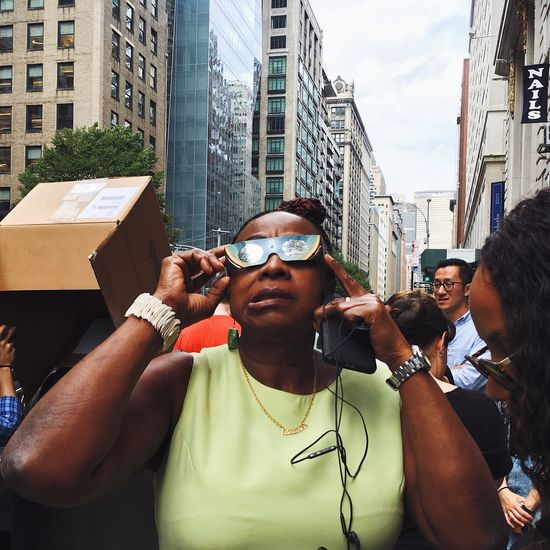 Experiencing the eclipse in apprehensive manner. EyeEm Best Shots City Day Eclipse 2017 Eye4photography  Outdoors Real People Streetphotography