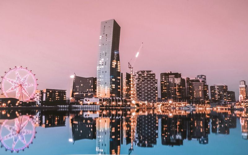 Melben Building Exterior Architecture Built Structure City Skyscraper Office Building Exterior Illuminated Cityscape Water Reflection Nature Sky Building Landscape Travel Destinations No People Pink Color Modern Night Tower
