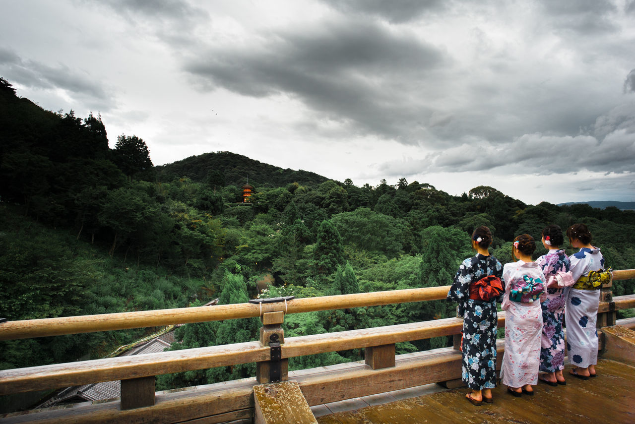 cloud - sky, sky, real people, traditional clothing, mountain, men, full length, togetherness, large group of people, religion, nature, women, tree, outdoors, day, landscape, bride, adult, people
