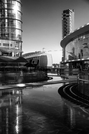 Architecture Blackandwhite Blackandwhite Photography Building Exterior Built Structure City City Life Citylife Clear Sky Illuminated Milano Milanocity Night No People Outdoors Reflctions Reflection Sky Street Street Photography Travel Destinations Water Waterfront Work Working