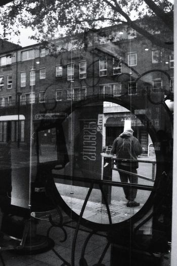 Londliness. Londra Early Years Loneliness EyeEmNewHere Real People Walking Around Noir Et Blanc Film Noir 35mm Film Photography Analogue Photograhy Filmsnotdead EyeEm Gallery Black & White Photography BW_photography Portraits PortraitPhotography Mirror Reflection The Week On EyeEm One Person Humans Filmphoto Streetphotography Streetphotographer Filmisalive Waiting Postcode Postcards Black And White Friday Stories From The City