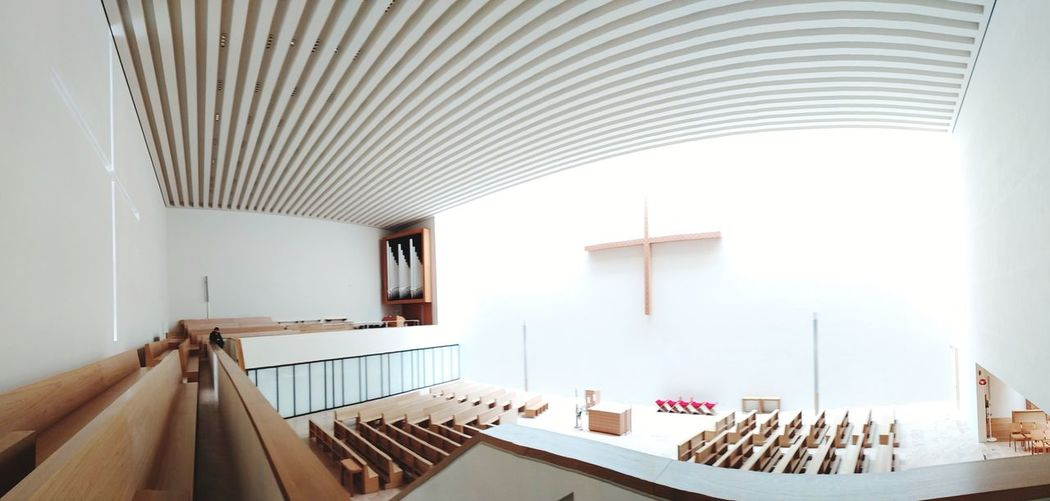 High Angle View Of Empty Pews In Church