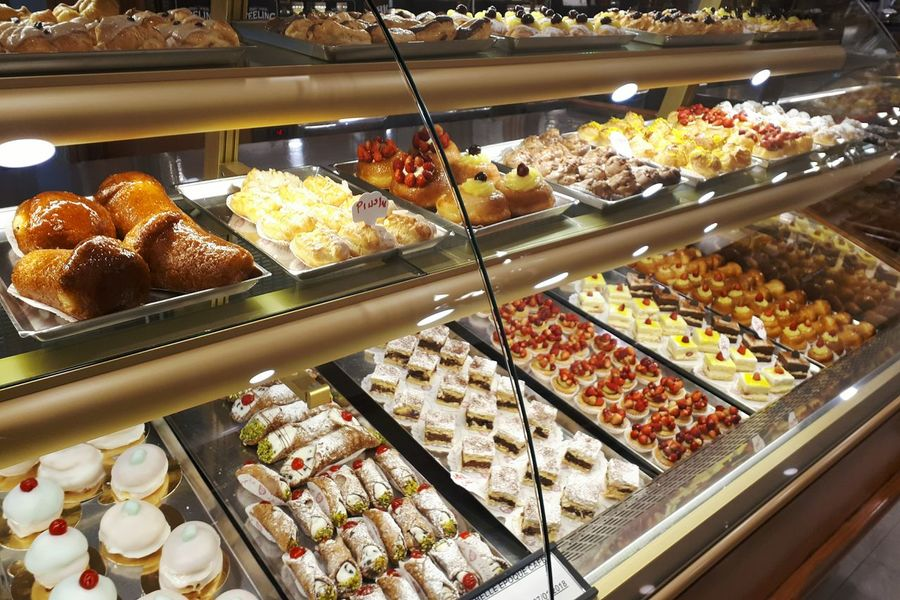 Pasticceria napoletana.. Dolcetto Baba Sfogliatelle Cannoli Siciliani Indulgence Sweet Food Food Food And Drink Dessert Unhealthy Eating Bakery Indoors  Freshness Display Cabinet Cake Ready-to-eat Baked For Sale Choice Retail