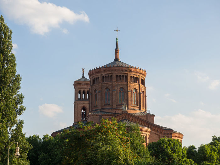 St. Thomas church in Berlin Berlin Church St. Thomas Architecture Belief Building Building Exterior Built Structure Cloud - Sky Day History Low Angle View Nature No People Outdoors Place Of Worship Plant Religion Sky Spire  Spirituality The Past Tower Tree