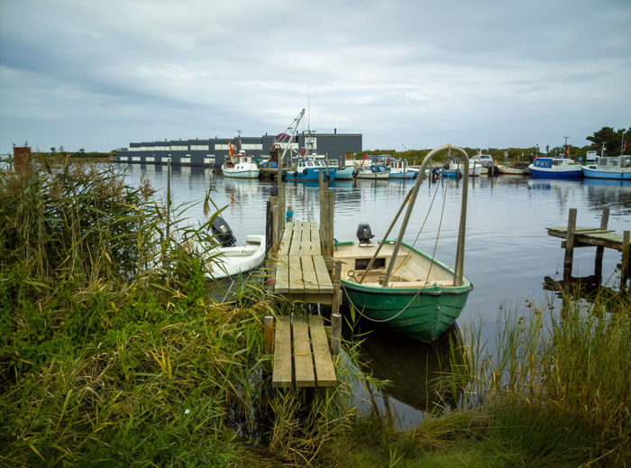 Architecture Bay Cloud - Sky Day Fishing Boat Grass Lake Mode Of Transportation Moored Nature Nautical Vessel No People Outdoors Pier Plant Sailboat Sky Transportation Water Wooden Post