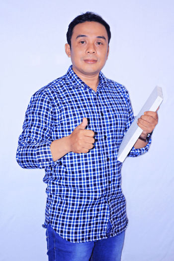 Asian College man with OK hand gesture Studio Shot Occupation Healthcare And Medicine Formal Portrait
