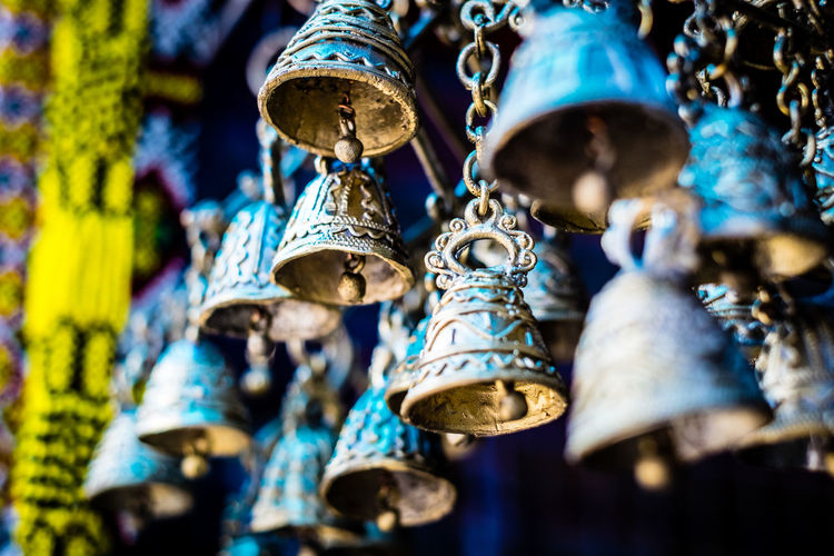 Low angle view of bells hanging for sale in market