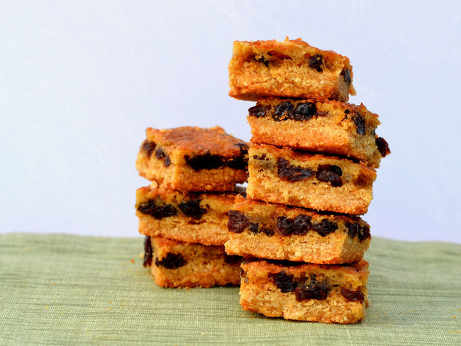 Stack of eight gluten free raisin squares or bars. Close up, side view. Almond Meal Bar Bars Butterfly Cake Coconut Flour Dessert Eight Free Gluten Gluten Free Gluten-free Health Food Healthy Linchbox Food Raisin Squares Raisins SLICE Slices Snack Stack Stacked Sweet Thompson Raisins Treat
